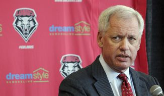 FILE - In this May 3, 2017, file photo, University of New Mexico athletics director Paul Krebs answers questions during a news conference in Albuquerque, N.M. Agents with the state attorney general's office have seized documents from the University of New Mexico Lobo Club as part of an ongoing investigation into questionable spending by the school's troubled athletics department. (AP Photo/Susan Montoya Bryan, File)