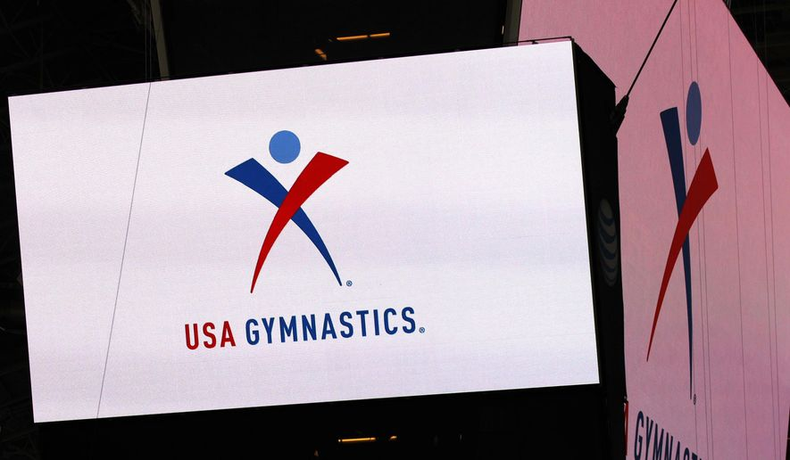 FILE - In this Feb. 26, 2014, file photo, the USA Gymnastics logo is displayed at AT&T Stadium during an news conference announcing in Arlington, Texas. USA Gymnastics has filed a Chapter 11 bankruptcy petition on Wednesday, Dec. 5, 2018, as it attempts to reach settlements in the dozens of sex-abuse lawsuits it faces and to forestall its potential demise at the hands of the U.S. Olympic Committee.(Ron Jenkins/Star-Telegram via AP) **FILE**