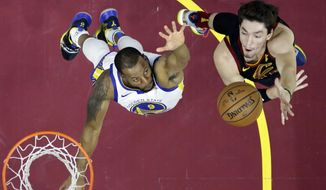 Cleveland Cavaliers' Cedi Osman, right, from Turkey, shoots over Golden State Warriors' Andre Iguodala in the first half of an NBA basketball game, Wednesday, Dec. 5, 2018, in Cleveland. (AP Photo/Tony Dejak)