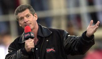 XFL founder Vince McMahon addresses the crowd at the start of the inaugural XFL game in Las Vegas on Saturday, Feb. 3, 2001 where the Las Vegas Outlaws are matched against the New York/New Jersey Hitmen.. (AP Photo/Laura Rauch) **FILE**