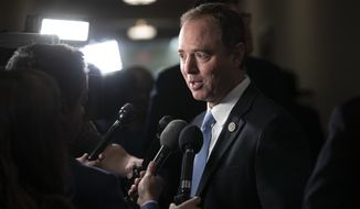 Rep. Adam Schiff, D-Calif., expected to become chairman of the House Intelligence Committee, speaks with reporters as he arrives for Democratic leadership elections on Capitol Hill in Washington, Wednesday, Nov. 28, 2018.  (AP Photo/J. Scott Applewhite)