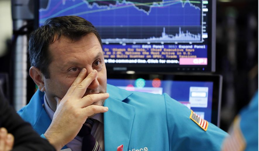 Specialist Vincent Surace works on the floor of the New York Stock Exchange, Thursday, Dec. 6, 2018. U.S. stocks tumbled again Thursday as the arrest of a senior Chinese technology executive threatened to cause another flare-up in tensions between Washington and Beijing. (AP Photo/Richard Drew)