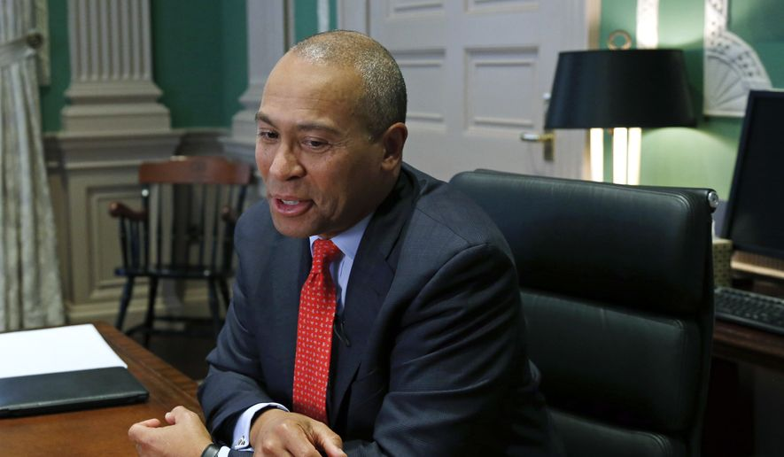 In this Monday, Dec. 15, 2014, file photo, Massachusetts Gov. Deval Patrick speaks during an interview at his Statehouse office in Boston. (AP Photo/Elise Amendola) ** FILE **