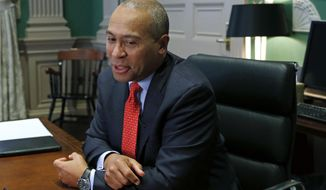 In this Monday, Dec. 15, 2014 photo, Massachusetts Gov. Deval Patrick speaks during an interview at his Statehouse office in Boston. As he prepares to leave office, Gov. Patrick says he is proud of many of the accomplishments of the past two terms. In a wide-ranging interview with the Associated Press, the governor cited strong employment gains and the foothold the state has in cutting-edge industries such as biotechnology, clean energy and advanced manufacturing. (AP Photo/Elise Amendola)