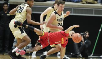 Maryland guard Anthony Cowan Jr. (1) loses the ball in front of Purdue forward Grady Eifert (24) and guard Nojel Eastern (20) during the second half of an NCAA college basketball game in West Lafayette, Ind., Thursday, Dec. 6, 2018. Purdue defeated Maryland 62-60. (AP Photo/Michael Conroy)