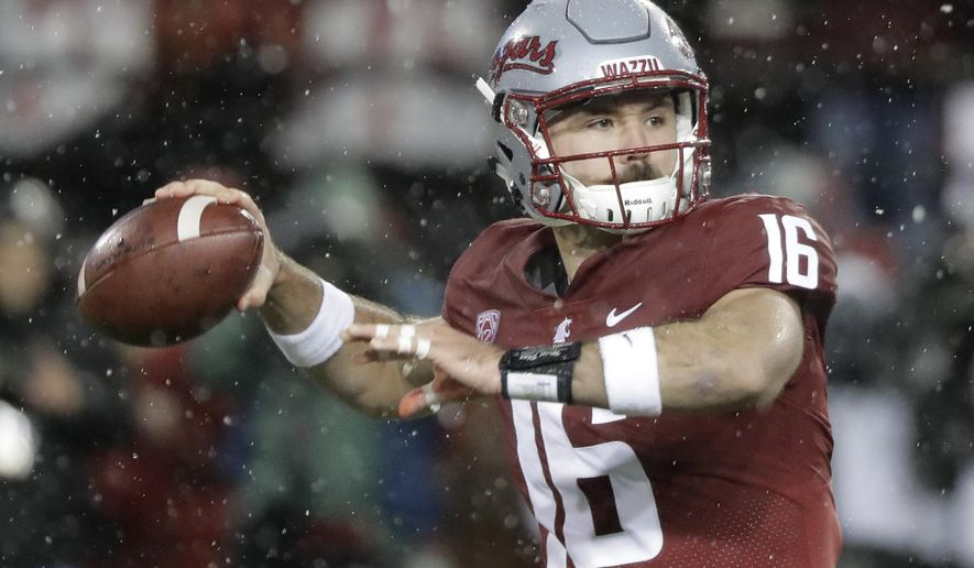 FILE - In this Nov. 23, 2018, file photo, Washington State quarterback Gardner Minshew passes against Washington during the first half of an NCAA college football game in Pullman, Wash. Minshew was named the Pac-12 offensive player of the year and the newcomer of the year Thursday, Dec. 6, 2018. (AP Photo/Ted S. Warren, File)