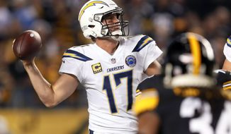 FILE - In this Dec. 2, 2018, file photo, Los Angeles Chargers quarterback Philip Rivers (17) passes as Pittsburgh Steelers strong safety Terrell Edmunds (34) rushes toward him in the first half of an NFL football game in Pittsburgh. The Chargers are coming off a big win at Pittsburgh and have a key AFC West showdown next week at Kansas City. But it is the game Sunday, Dec. 9, 2018, against Cincinnati that concerns coach Anthony Lynn the most. (AP Photo/Don Wright, File)