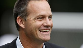 FILE - In this June 5, 2012, file photo, then-Cal FC head coach Eric Wynalda smiles before a U.S. Open Cup fourth-round soccer match against the Seattle Sounders, in Tukwila, Wash. Wynalda and Las Vegas Lights FC are running a job search unlike any other on the Strip at the moment. Not that you would expect anything less from the United Soccer League team that partnered with a marijuana dispensary, dropped $5,000 from a helicopter as part of a halftime promotion and embraced gambling like no American sports franchise ever before. (AP Photo/Elaine Thompson, File)