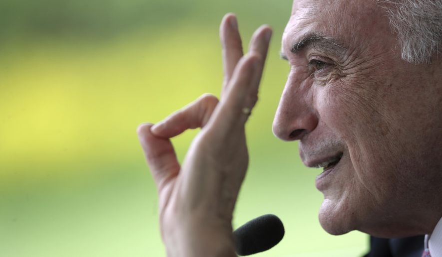"""Brazil's President Michel Temer speaks during a breakfast with foreign correspondents in the presidential residence in Brasilia, Brazil, Thursday, Dec. 6, 2018. Temer says he is not """"the least bit worried"""" about corruption charges against him that could lead to jail time after he leaves office on Jan. 1. (AP Photo/Eraldo Peres)"""