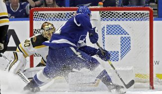Tampa Bay Lightning center Anthony Cirelli (71) beats Boston Bruins goaltender Tuukka Rask (40) for a goal during the third period of an NHL hockey game Thursday, Dec. 6, 2018, in Tampa, Fla. (AP Photo/Chris O'Meara)