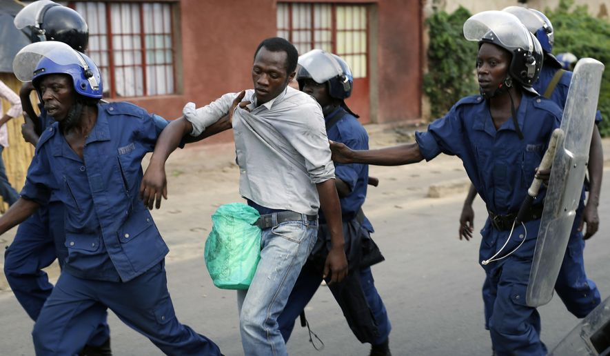"""FILE - In this Tuesday, April 28, 2015, file photo, Burundi riot police detain a man suspected of throwing stones during clashes in the Musaga district of Bujumbura, Burundi. The United Nations human rights office on Thursday, Dec. 6, 2018, said Burundi's government has asked it to leave, months after the outgoing U.N. rights chief called the country one of the """"most prolific slaughterhouses of humans in recent times."""" (AP Photo/Jerome Delay/File)"""