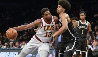 Cleveland Cavaliers center Tristan Thompson (13) pushes in on Brooklyn Nets guard Allen Crabbe (33) in the first half of an NBA basketball game, Monday, Dec. 3, 2018, in New York. (AP Photo/Howard Simmons)