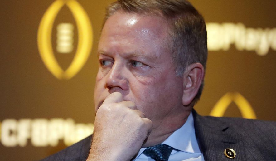 Notre Dame coach Brian Kelly listens during a news conference Thursday, Dec. 6, 2018, in Atlanta. Notre Dame is one of the four teams in the College Football Playoff. (AP Photo/John Bazemore)