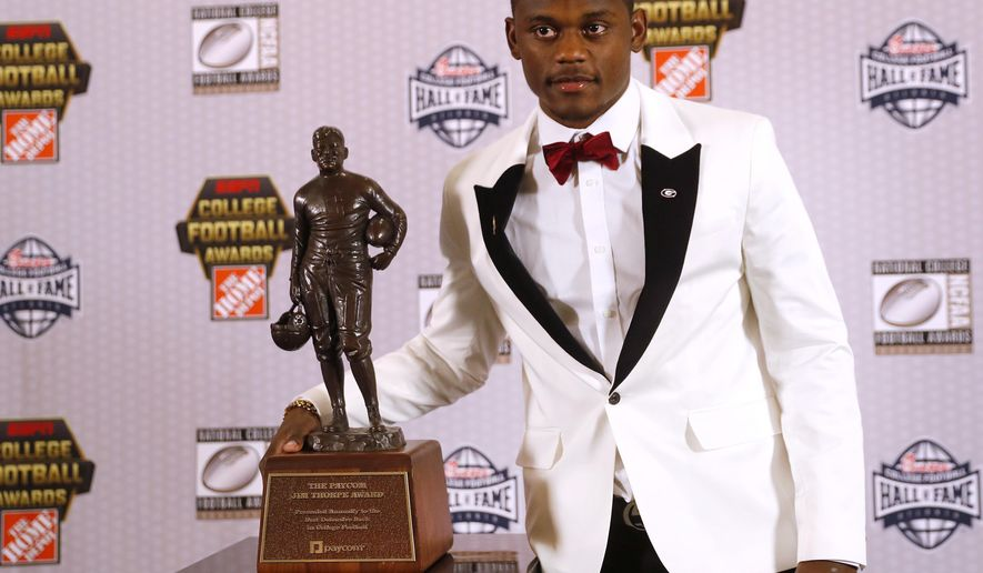 Georgia's Deandre Baker poses with the trophy after winning the Jim Thorpe Award as top defensive back in college football Thursday, Dec. 6, 2018, in Atlanta. (AP Photo/John Bazemore)