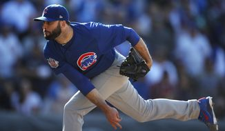 FILE - In this April 22, 2018, file photo, Chicago Cubs relief pitcher Brandon Morrow delivers to Colorado Rockies' David Dahl in the ninth inning of a baseball game in Denver. Cubs closer Morrow likely will miss the start of the season following arthroscopic surgery on his right elbow last month. President of baseball operations Theo Epstein says the operation took place Nov. 6, 2018. (AP Photo/David Zalubowski, File)