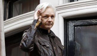 In this May 19, 2017 file photo, WikiLeaks founder Julian Assange greets supporters from a balcony of the Ecuadorian embassy in London. (AP Photo/Frank Augstein) **FILE**