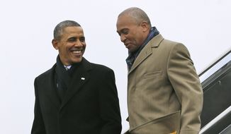 In this March 5, 2014, file photo, then-President Barack Obama, left, speaks with Massachusetts Gov. Deval Patrick upon arrival on Air Force One at Boston Logan International Airport in Boston. (AP Photo/Pablo Martinez Monsivais, File)