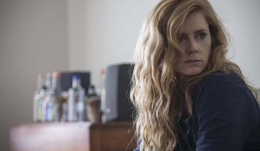 "This image released by HBO shows Amy Adams in a scene from ""Sharp Objects."" On Thursday, Dec. 6, 2018, the program was nominated for a Golden Globe award for best limited series or TV movie. The 76th Golden Globe Awards will be held on Sunday, Jan. 6. (Anne Marie Fox/HBO via AP)"