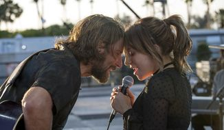 """This image released by Warner Bros. shows Bradley Cooper, left, and Lady Gaga in a scene from the latest reboot of the film, """"A Star is Born."""" On Thursday, Dec. 6, 2018, the film was nominated for a Golden Globe award for best motion picture drama. The 76th Golden Globe Awards will be held on Sunday, Jan. 6. (Neal Preston/Warner Bros. via AP)"""