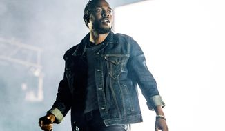 """FILE - In this July 7, 2017, file photo, Kendrick Lamar performs during the Festival d'ete de Quebec in Quebec City, Canada. Lamar was nominated for a Golden Globe for best original song for """"All the Stars,"""" from the film """"Black Panther."""" He shares the nomination with Anthony Tiffith, Mark Spears, Solana Rowe and Al Shuckburgh.  The 76th Golden Globe Awards will be held on Sunday, Jan. 6.  (Photo by Amy Harris/Invision/AP, File)"""