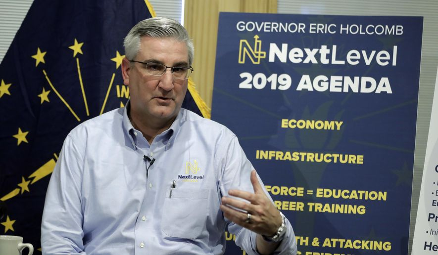 Indiana Gov. Eric Holcomb speaks about his agenda priorities for the upcoming legislative session, Thursday, Dec. 6, 2018, in Zionsville, Ind. Holcomb is aiming to preserve Indiana's $1.8 billion state budget surplus while not directing more money toward goals of increasing teacher pay or expanding the state-funded preschool program. (AP Photo/Darron Cummings)