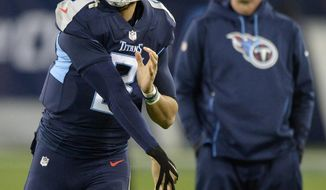 Tennessee Titans quarterback Marcus Mariota (8) warms up with tape on his throwing hand before the first half of an NFL football game against the Jacksonville Jaguars, Thursday, Dec. 6, 2018, in Nashville, Tenn. (AP Photo/Mark Zaleski)