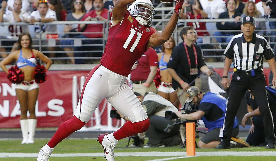 FILE - In this Nov. 18, 2018, Arizona Cardinals wide receiver Larry Fitzgerald (11) pulls in a touchdown catch against the Oakland Raiders during the first half of an NFL football game in Glendale, Ariz. Fitzgerald needs one catch to pass Jerry Rice for most catches for one team in NFL history. (AP Photo/Rick Scuteri, File)