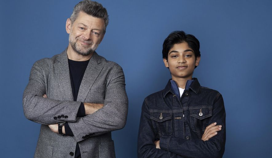 """In this Nov. 28, 2018 photo, Andy Serkis, left, and Rohan Chand pose for a portrait at the Four Seasons Hotel in Los Angeles to promote their film """"Mowgli: Legend of the Jungle,"""" streaming on Nextflix on Friday, Dec. 7. (Photo by Rebecca Cabage/Invision/AP)"""