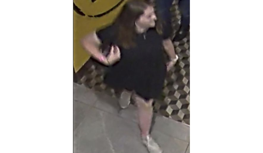 This Saturday, Dec. 1, 2018, CCTV image released by New Zealand Police shows 22-year-old English tourist Grace Millane in central Auckland, New Zealand. The image was captured on Saturday night, about 7:15 p.m. and is the last known sighting of Millane, whose 22nd birthday was the next day. (NZ Police via AP)