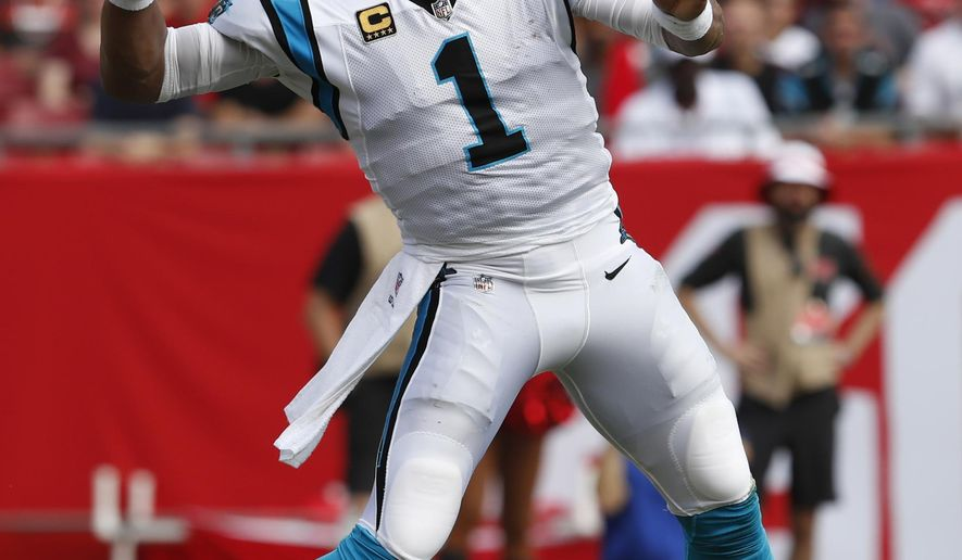 FILE - In this Dec. 2, 2018, file photo, Carolina Panthers quarterback Cam Newton (1) throws a pass against the Tampa Bay Buccaneers during the first half of an NFL football game, in Tampa, Fla. The Panthers play the Cleveland Browns in Cleveland on Sunday. (AP Photo/Mark LoMoglio, File)