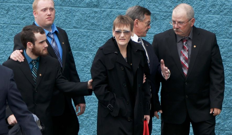 Family members of U.S. Air Force Staff Sgt. Dylan J. Elchin arrive for his memorial service on Thursday, Dec. 6, 2018, in Moon Township, Pa. Loney Duez, Elchin's stepfather, right, walks with Elchins mother Dawna Duez, center, along with brothers Aaron Elchin, second from left, and Zachery Bly, left. Elchin was one of three servicemen killed last month when their vehicle was destroyed by an improvised explosive device in Andar, in Afghanistan's Ghazni Province. (AP Photo/Keith Srakocic)