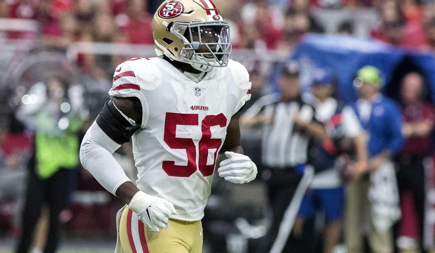 """FILE - In this Oct. 28, 2018, file photo, San Francisco 49ers' Reuben Foster (56) jogs on the field during the first half of an NFL football game against the Arizona Cardinals in Glendale, Ariz. Foster's ex-girlfriend tells ABC's """"Good Morning America"""" that he slapped her and pushed her during an incident in Tampa, Fla., that led to his arrest for domestic violence. Elissa Ennis says in an interview televised Thursday, Dec. 6, 2018, that Foster abused her three times, most recently last month in Tampa. (AP Photo/Darryl Webb) ** FILE **"""