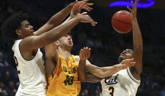 From left, California's Andre Kelly, San Francisco's Matt McCarthy, and California's Paris Austin (3) fight for a loose ball in the second half of an NCAA college basketball game, Wednesday, Dec. 5, 2018, in Berkeley, Calif. (AP Photo/Ben Margot)