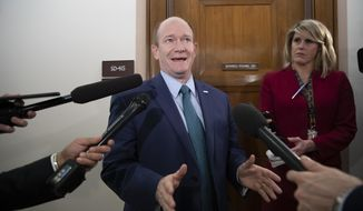 Sen. Chris Coons, D-Del., a member of the Senate Foreign Relations Committee, speaks with reporters as senators are considering multiple pieces of legislation in an effort to formally rebuke Saudi Arabia for the slaying of journalist Jamal Khashoggi, on Capitol Hill in Washington, Thursday, Dec. 6, 2018. . (AP Photo/J. Scott Applewhite)