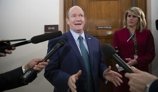 Sen. Chris Coons, D-Del., a member of the Senate Foreign Relations Committee, speaks with reporters on Capitol Hill in Washington, Thursday, Dec. 6, 2018. (AP Photo/J. Scott Applewhite) ** FILE **