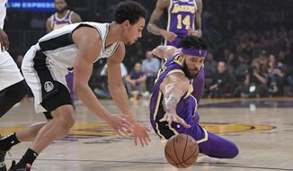 San Antonio Spurs guard Bryn Forbes, left, and Los Angeles Lakers center JaVale McGee go after a loose ball during the first half of an NBA basketball game, Wednesday, Dec. 5, 2018, in Los Angeles. (AP Photo/Mark J. Terrill)