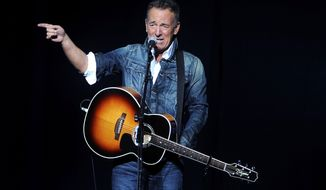 "FILE - In this Nov. 5, 2018, file photo, Bruce Springsteen performs at the 12th annual Stand Up For Heroes benefit concert at the Hulu Theater at Madison Square Garden in New York. Springsteen will not be touring with the E Street Band in 2019. Springsteen on Tuesday, Dec. 4, posted on Twitter that they hope to be back soon. But The Boss says he wants a break after his ""Springsteen on Broadway"" show wraps up on Dec. 15 and he's working on various recording projects. (Photo by Brad Barket/Invision/AP, File)"