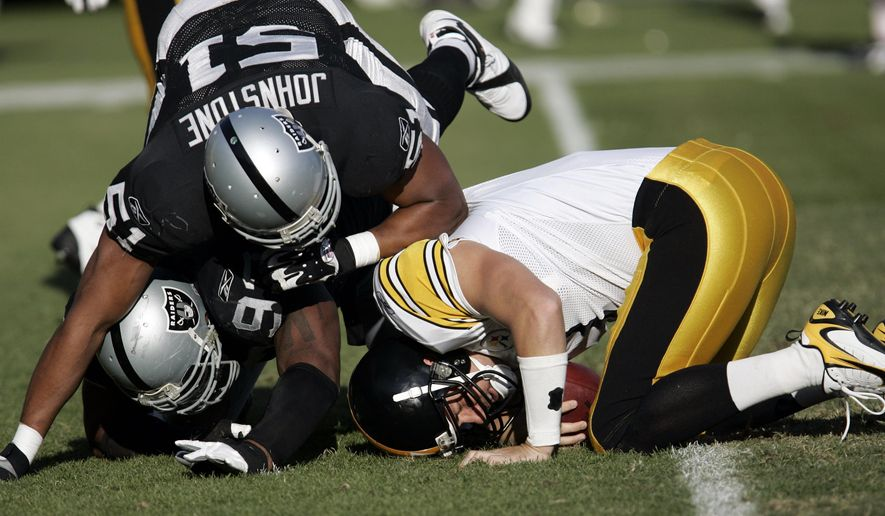 FILE - In this Oct. 29, 2006, file photo, Pittsburgh Steelers quarterback Ben Roethlisberger (7) is sacked by Oakland Raiders defensive end Lance Johnstone (51) in the third quarter of an NFL football game, in Oakland, Calif. While Big Ben has had success almost everywhere he has played, he's still looking for his first career win in Oakland. (AP Photo/Paul Sakuma, File)