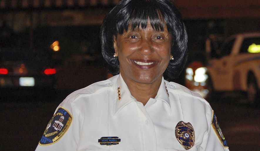 In this 2013 photo, former Canton, Miss., police chief Vickie McNeil smiles in Canton, Miss. McNeil is among six people indicted on accusations that they tried to influence a 2017 election in a central Mississippi city by improperly helping people fill out absentee ballots and voting despite being disqualified. (The Clarion-Ledger via AP)