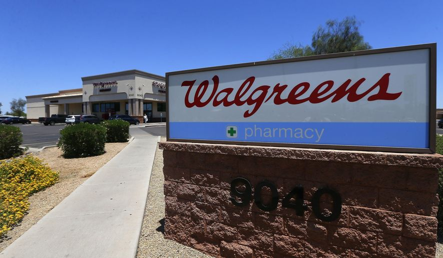 FILE- In this June 25, 2018, file photo shows a Walgreens store in Peoria, Ariz. Walgreens is joining drugstore competitor CVS Health in launching home deliveries for prescriptions nationwide, as stores continue adjusting to a retail world made more customer-friendly by online competition. (AP Photo/Ross D. Franklin, File)