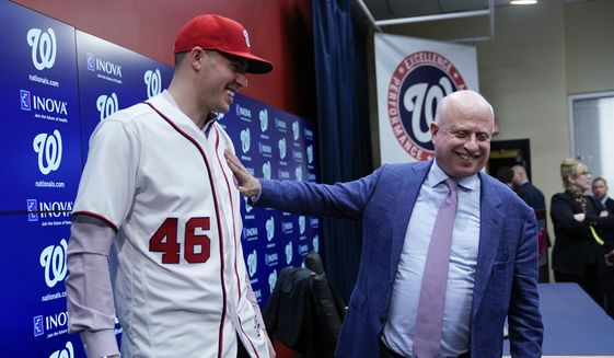 Washington Nationals owner Mark Lerner, right, greets pitcher Patrick Corbin, left, during a baseball news conference at Nationals Park in Washington, Friday, Dec. 7, 2018. Corbin agreed to terms on a six-year contract and joins the Nationals after playing for the Arizona Diamondbacks. (AP Photo/Pablo Martinez Monsivais) **FILE**
