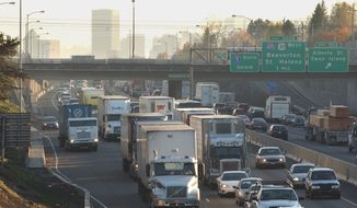 FILE- In this Nov. 17, 2005, file photo, traffic moves on Interstate 5 in downtown Portland, Ore. Oregon is seeking federal approval to toll two Portland-area freeways. The Oregon Transportation Commission voted unanimously on Thursday, Dec. 6, 2018, to send its tolling proposal to the Federal Highway Administration. (AP Photo/Greg Wahl-Stephens, File)