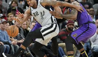 San Antonio Spurs' Rudy Gay (22) fights for the ball against Los Angeles Lakers' LeBron James, right, and JaVale McGee during the first half of an NBA basketball game Friday, Dec. 7, 2018, in San Antonio. (AP Photo/Darren Abate)