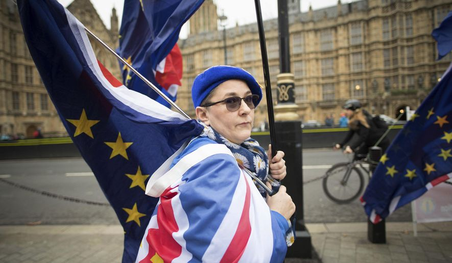 Anti Brexit demonstrators protest outside the Houses of Parliament in London Thursday Dec. 6, 2018.  Britain's Prime Minister Theresa May's effort to win support for her Brexit agreement comes amid reports in British newspapers Thursday, predicting that Parliament could reject the deal by more than 100 votes. (Stefan Rousseau/PA via AP)