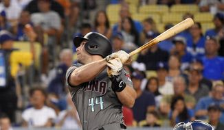 FILE - In this Aug. 31, 2018 file photo Arizona Diamondbacks' Paul Goldschmidt hits a two-run home run during the first inning of a baseball game against the Los Angeles Dodgers in Los Angeles. The St. Louis Cardinals have acquired Goldschmidt from the Diamondbacks in a multiplayer trade. The Cardinals sent pitcher Luke Weaver, catcher Carson Kelly, minor league infielder Andy Young and a 2019 draft pick to Arizona in the deal Wednesday, Dec. 5, 2018. (AP Photo/Mark J. Terrill)