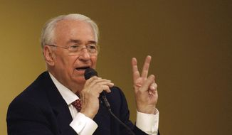 FILE - In this July 23, 2004 file photo, Colombia's former President Belisario Betancur speaks during a conference about democracy in Latin America in Panama City. Betancur died Friday, Dec. 7, 2018, at a clinic in Bogota. He was 95.  (AP Photo/Kathryn Cook, File)