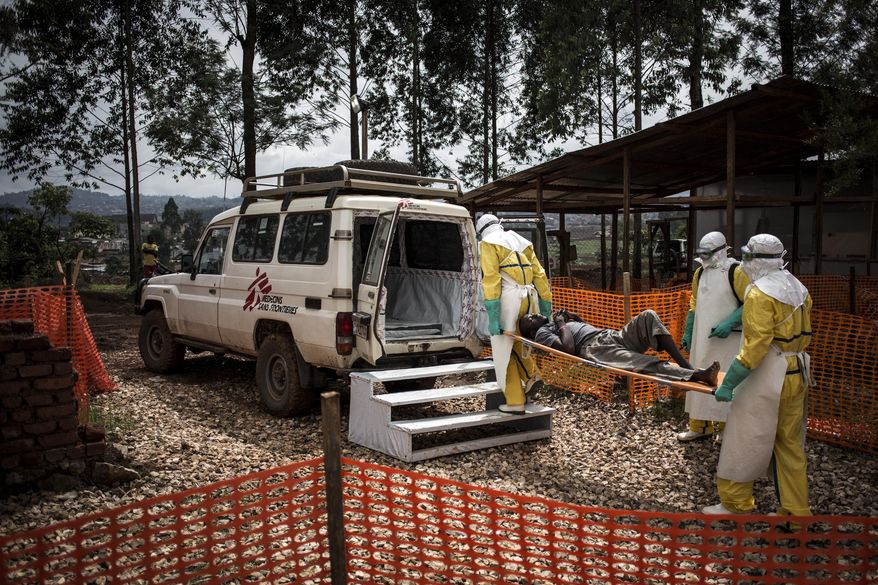 In this photo taken Sunday, Nov. 4, 2018 and made available Tuesday, Dec. 4, 2018, health workers move a patient to a hospital after he was cleared of having Ebola inside of a Medecins Sans Frontieres (MSF) supported Ebola treatment centre in Butembo, Congo. Congo's deadly Ebola outbreak is now the second largest in history, behind the devastating West Africa outbreak that killed thousands a few years ago, according to the World Health Organization. (John Wessels/Medecins Sans Frontieres via AP)
