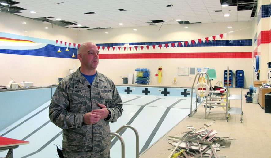 Air Force Col. Michael Staples shows damage from the powerful Nov. 30 earthquake, at Joint Base Elmendorf-Richardson Friday, Dec. 7, 2018, in Anchorage, Alaska. The magnitude 7.0 earthquake caused multiple problems around the base, including damage to steel frameworks, ceilings, and sprinkler and heating systems, but no catastrophic damage. (AP Photo/Rachel D'Oro)