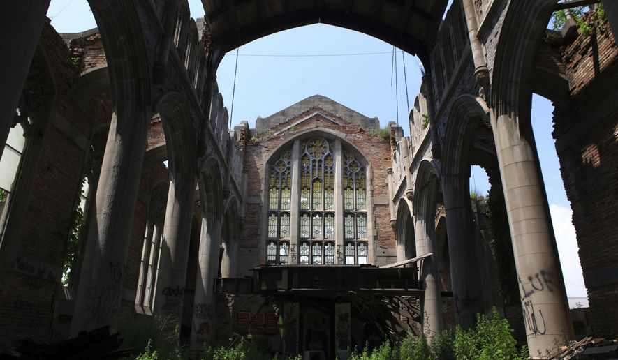 In this June 30, 2018 photo, the historic City Methodist Church, in Gary, Ind., plagued by human health threats, must be remediated before the city can transform the architectural gem into a European-style ruins garden and tourist attraction, records show. A plan to turn the ruins of a historic Indiana church into a tourist attraction can't move forward until asbestos and other potential health hazards are removed from the property. (Kale Wilk/The Times via AP)