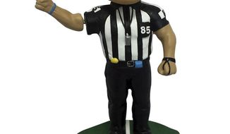 This undated photo provided by the National Bobblehead Hall of Fame and Museum, shows a bobblehead featuring former legendary NFL referee, Ed Hochuli, who retired following the 2017 NFL season. Hochuli officiated for 28 seasons in the NFL from 1990 to 2017, spending 26 of those years as a referee. (National Bobblehead Hall of Fame and Museum via AP)